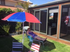 Lady Relaxing in Patio Area - Lock, Stock & Farrell Locksmith Perth